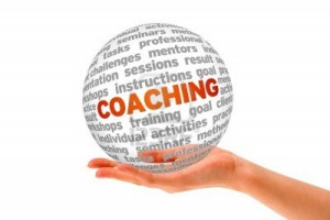 13027813-hand-holding-a-coaching-3d-sphere-on-white-background